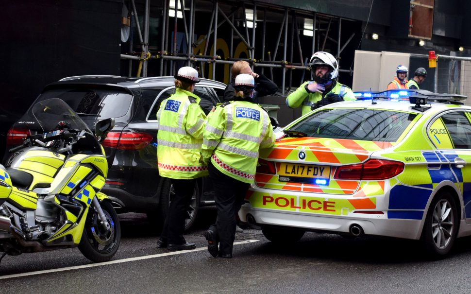 A thematic photo of police officers to show the piece is around vehicle crime
