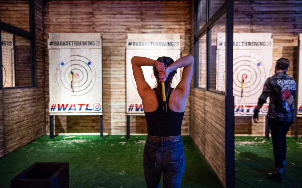 woman lining up to throw an axe at the target