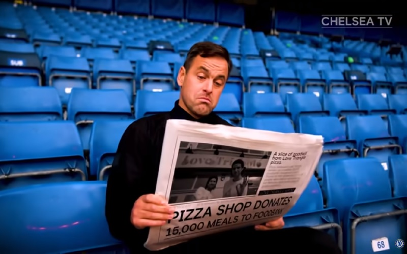 Joe Cole reading the paper as part of Chelsea's Proud of London campaign