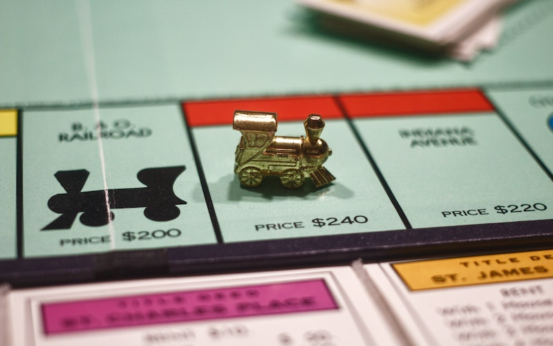 Train playable token on a classic Monopoly board
