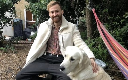 'Bees and Refugees' charity founder Ali Alzein sits with his white labrador in garden