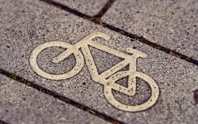 A bicycle symbol painted on a pavement