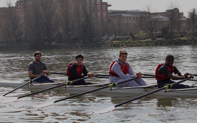 Students rowing on the river via Fulham Reach Boat Club.
