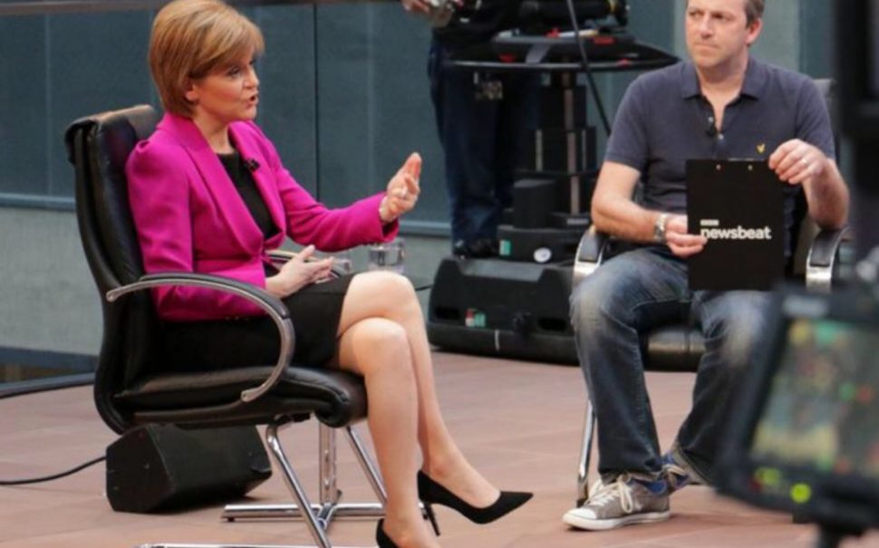 Nicola Sturgeon sitting in black church