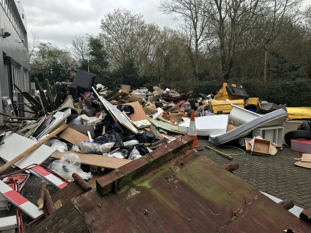Mattresses, sofas, building waste and a gritting container dumped in car park of Tolworth businesses.