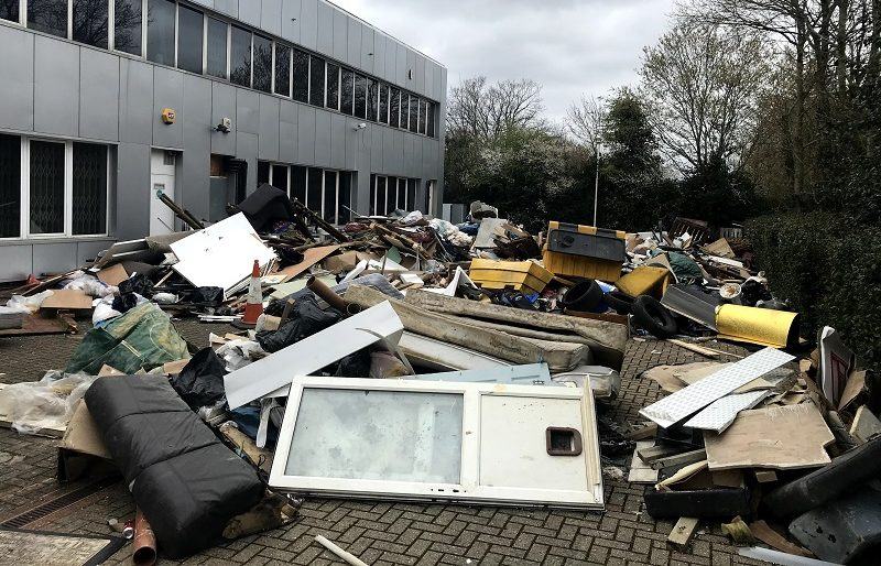 Flytipped waste in Tolworth business.