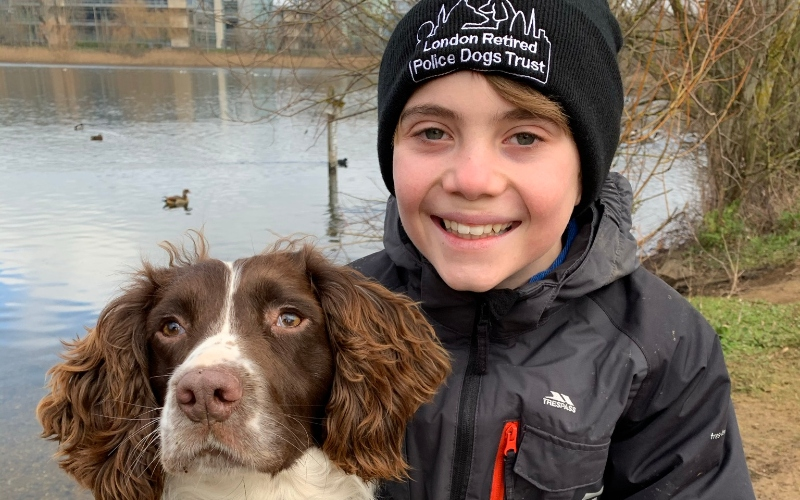 PC Phil Wells' son Thomas, 12, with police dog Parker