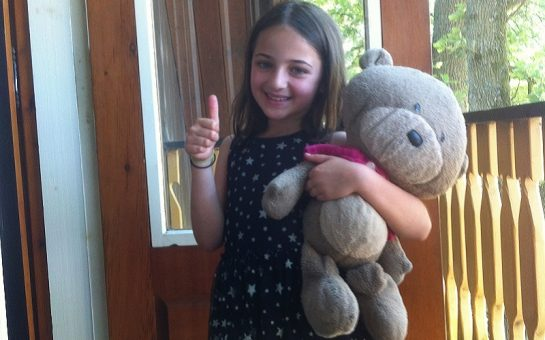 Mia Piesse with her bear ted, which inspired her book