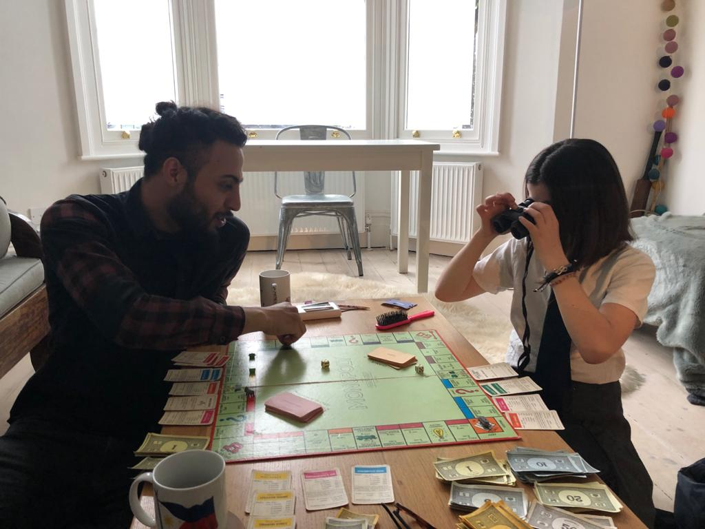 Picture of Yusuf playing monopoly