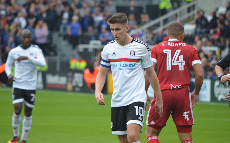 Tom Cairney on the football pitch in Fulham kit.