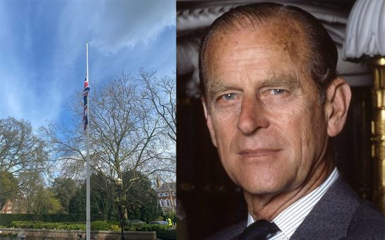 A Union flag at half mast in Richmond next to an image of the late Duke of Edinburgh to illustrate London MPs paying their respects