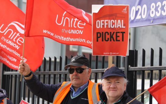 bus drivers carrying signs as part of their strike