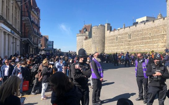 policeman amongst crowd outside windsor for the funeral of prince philip