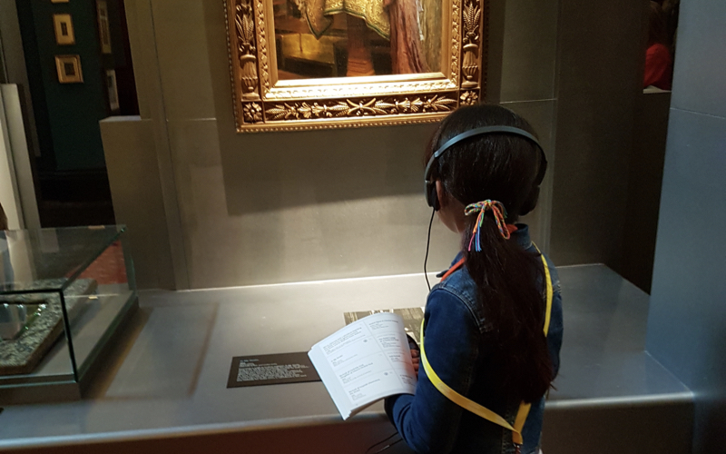 Primary school student looks at Leighton House art during a pre-lockdown workshop