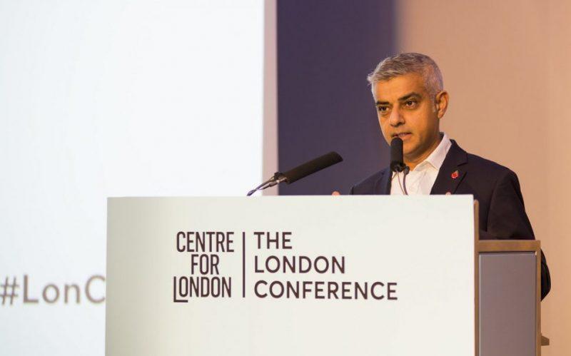 sadiq khan at a podium