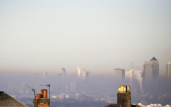 a picture of London's skyline in the winter with a smog covering buildings.