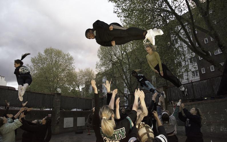 cheerleaders stunt, being thrown high in air