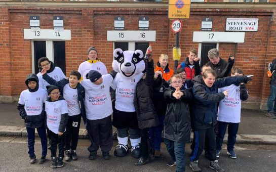 image of the matchday march 2020. Feature participants outside Craven Cottage and FFC mascot Billy the Badger