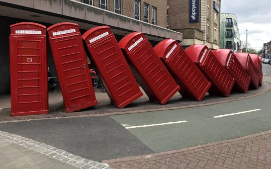 out of order red phone boxes sculpture in Kingston