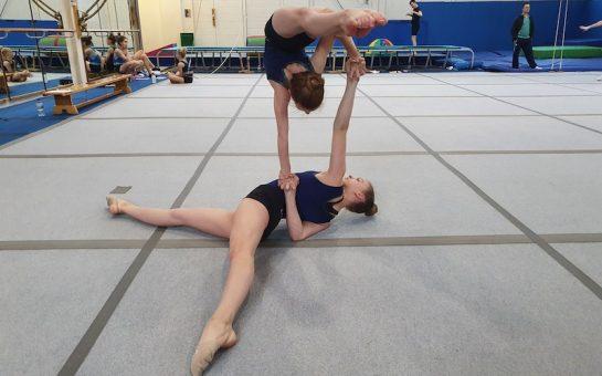 Two girls train together at the Richmond Gymnastics Association