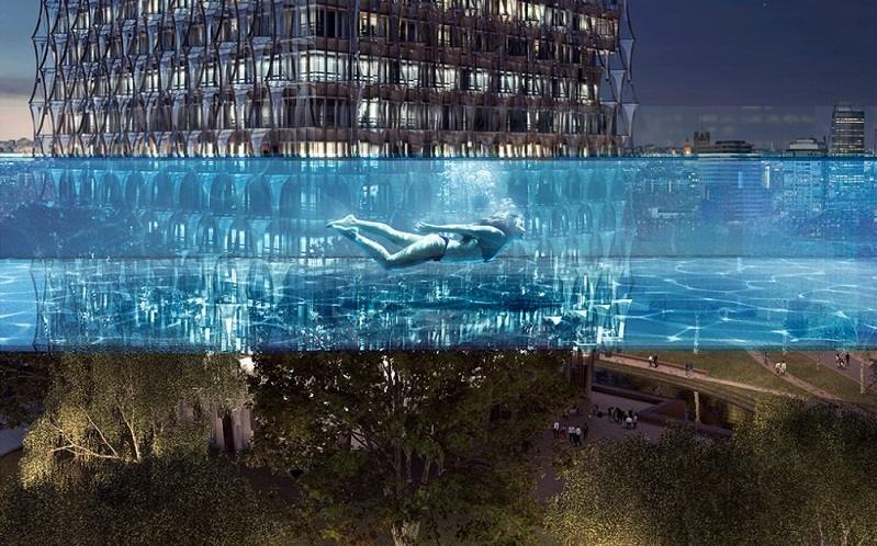 person swimming in the sky pool at night