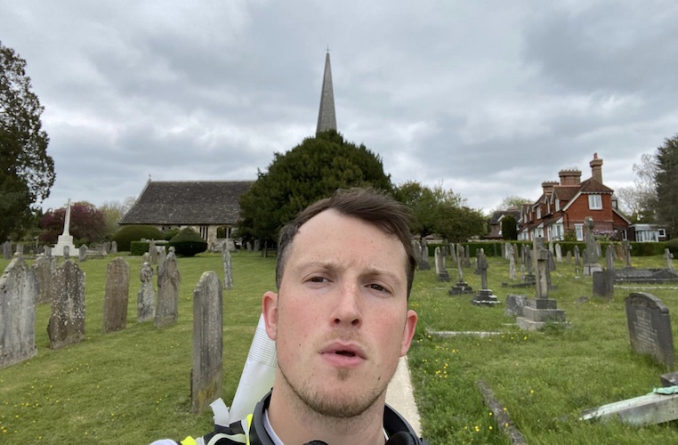 Ellis Tustin takes a selfie in a church graveyard during his journey from Fulham to Brighton.