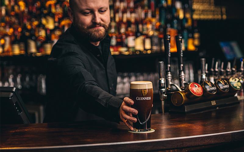 Homeboy bar serving pint of guinness