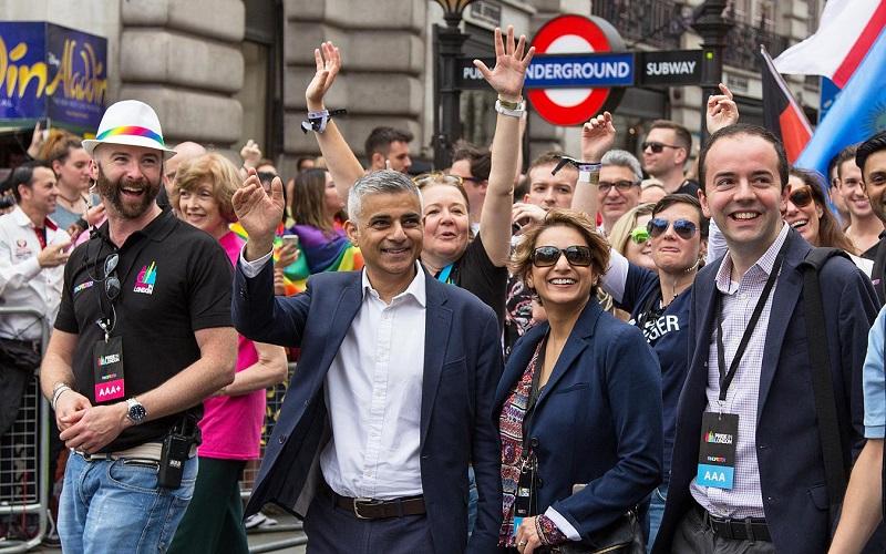 sadiq khan looking ecstatic outside a tube station
