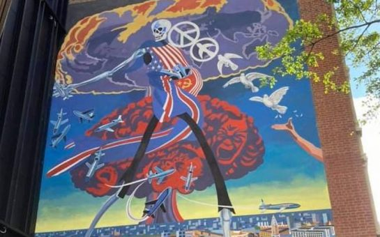 Mural depicting a skeleton walking over the city of London