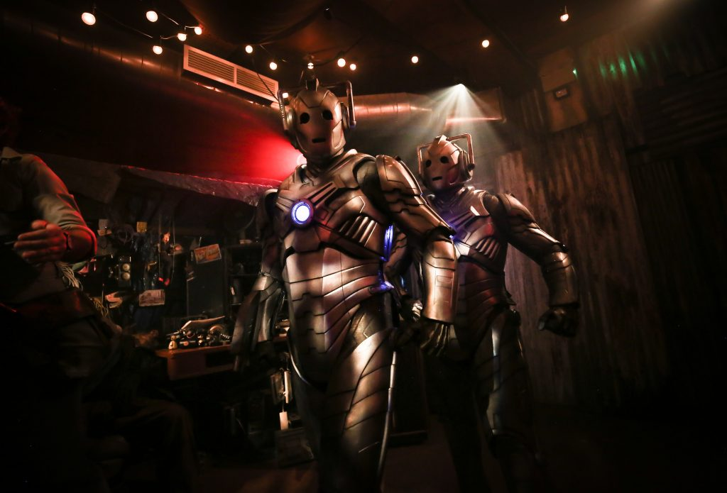 Two Cybermen in an alien marketplace as part of Doctor Who: Time Fracture. Credit: Mark Senior