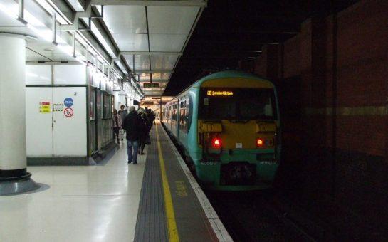 train on a shadowy platform at London Victoria