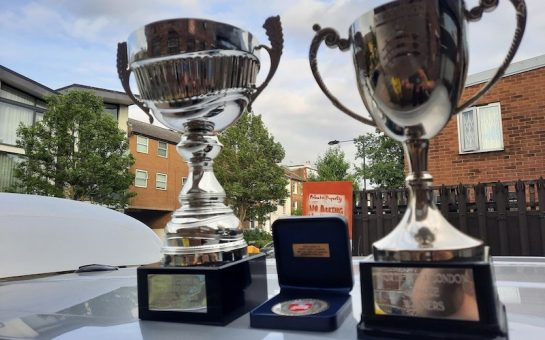 Photo of the cup and league trophy that Minds United FC won