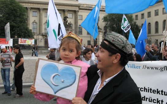 young girla nd her father protesting in Berlin.