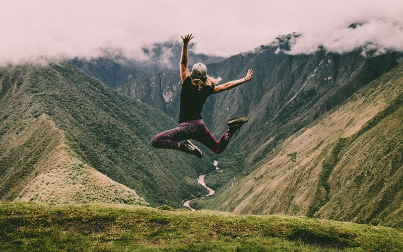 Man jumping in the air against a backdrop of nature