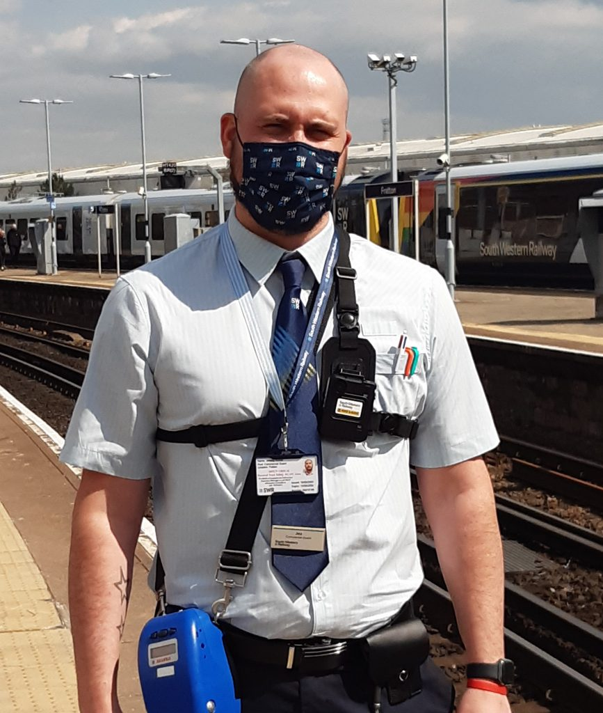 An SWR guard wearing a body cam at Fratton station, Portsmouth