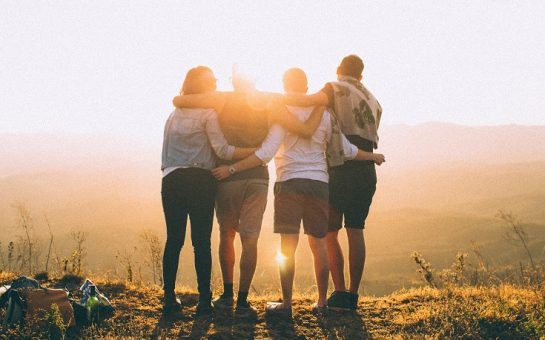 Group of friends with their arms around each other
