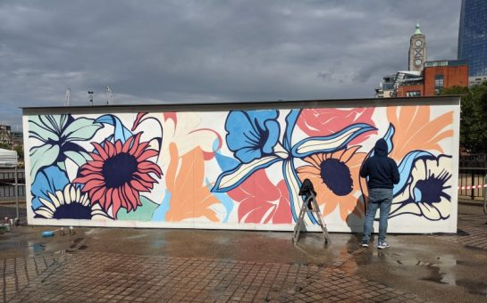 Artist Nerone painting his carbon-absorbing mural for Lindeman's on the South Bank