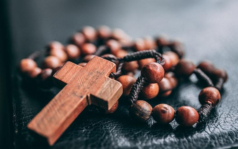 A wooden cross and prayer beads