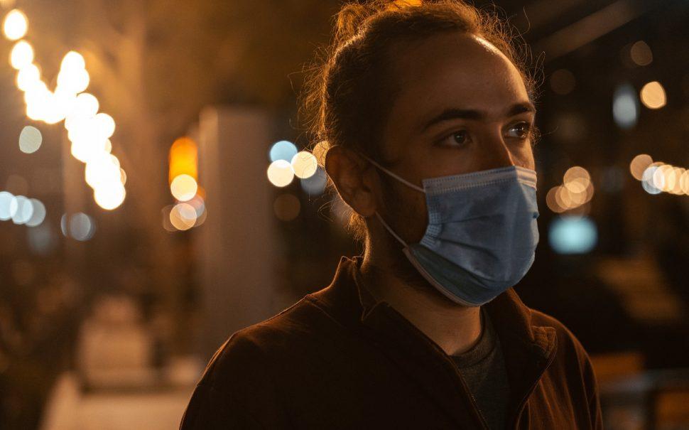 man wearing a mask at night