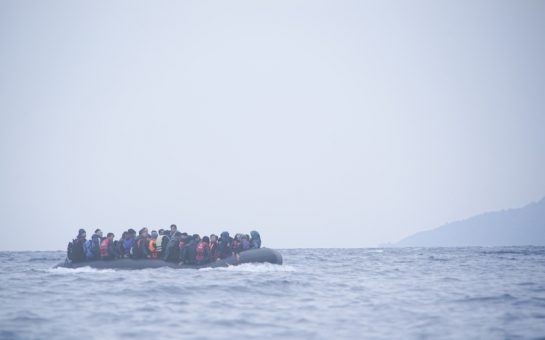 Refugees on a boat crossing the Mediterranean sea