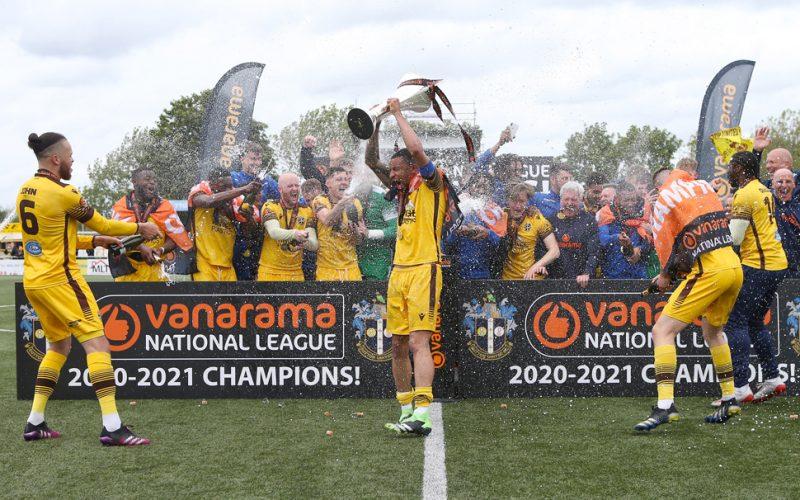Sutton United Craig Eastmond lifts trophy