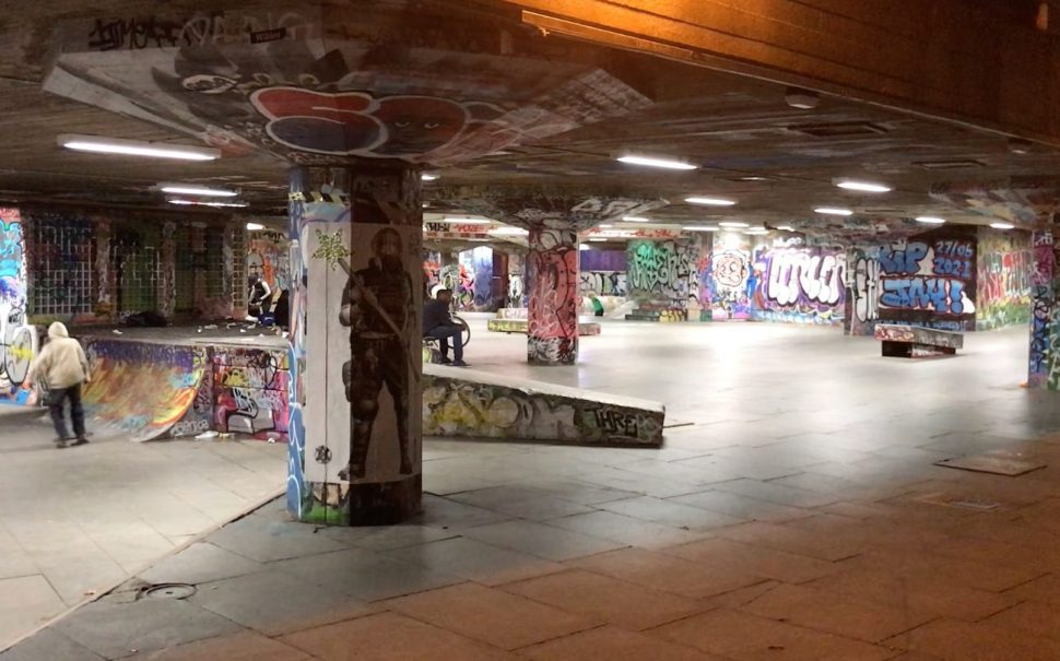 Southbank skateboard park at night with skaters