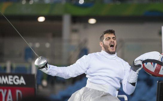 dimitri coutya celebrating his bronze medal