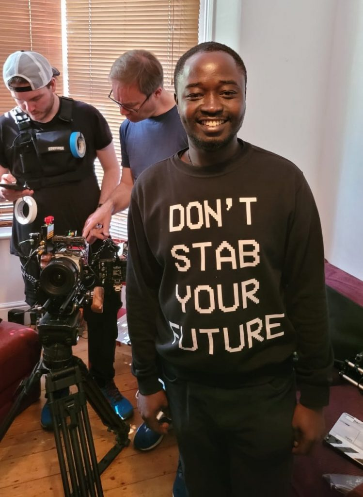 Executive producer Dennis Gyamfi on set