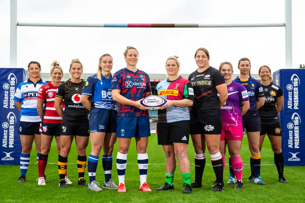 Representatives of all the Premier 15s team, including Harlequins skipper Rachel Burford, pose under the sticks at Twickenham Stoop