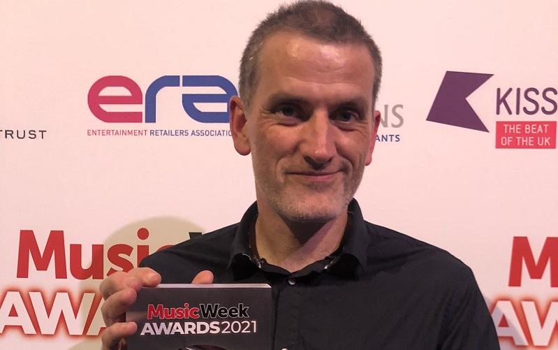 Jon Tolley holding Best Independent Retailer award