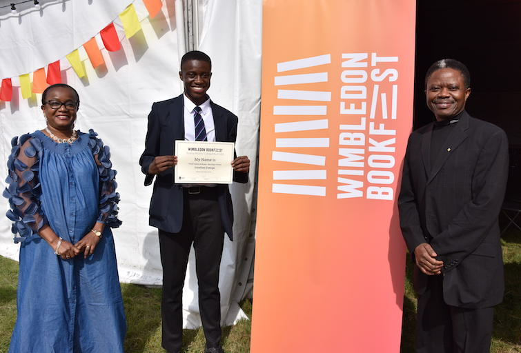 Winner of the Young Writers' Competition Jonathan Esenga, 14, with has mother Yvonne Esenga, 49, and his father, Eky Esenga, 60