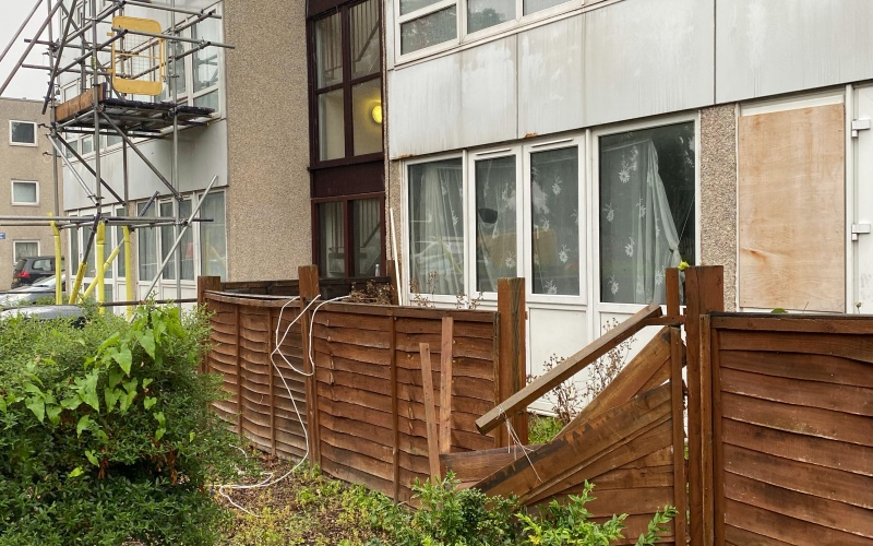 Residents are facing squalid housing with damaged fronts, scaffolding, broken fences and a missing window