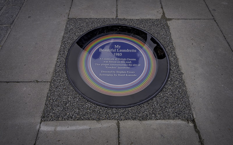 """A close-up of the rainbow plaque commemorating """"My Beautiful Laundrette"""" in Lambeth"""