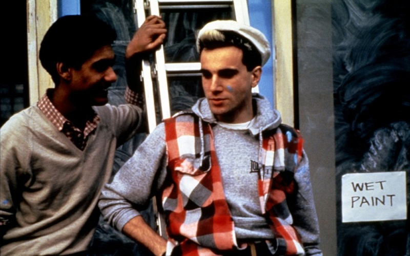 """A still from """"My Beautiful Laundrette"""" showing Omar and Johnny outside the laundrette."""